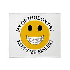 My Orthodontist Keeps Me Smiling Throw Blanket
