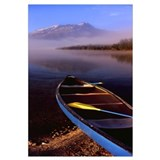 Canoe in lake in front of mountains, Leigh Lake, R