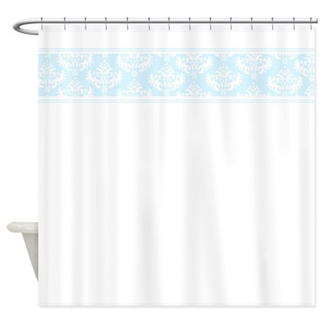 white shower curtain with pale blue damask trim