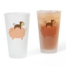 Baby Monkey Riding Backwards on a Pig Drinking Gla