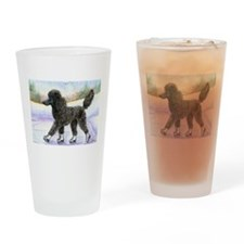Black poodle takes to the ice Drinking Glass