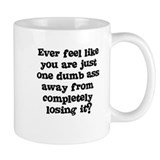 Ever feel like you are one dumb ass away Small Mugs