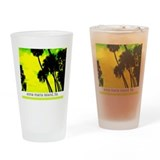 Palms against yellow sky Drinking Glass