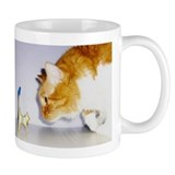 Humorous Cat Staring at Wooden Kitty Statue Mug