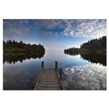 Dock in Lake Mapourika with mist rising off water,