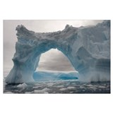 Iceberg with a natural arch, Antarctic Peninsula,
