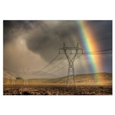 Powerlines, rainbow forms as evening sun lights up