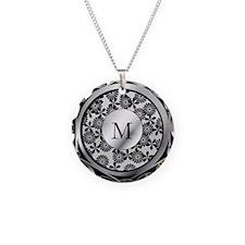 Ornate patterned monogram silver and black print N
