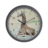 Young Giraffe at Rest Wall Clock