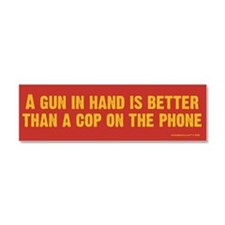 A Gun In Hand Car Magnet 10 x 3