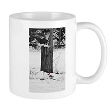 Cardinal in the snow Mug