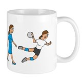 evolution female handball player comic Mug