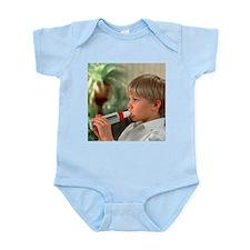 Lung function: boy breathes into peak flow meter -