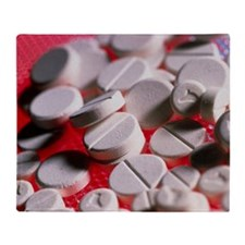 Close-up of large and small tablets of ecstasy -
