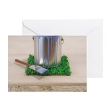 Paint can on patch of grass Greeting Card