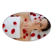 Woman covered in flower petals layi Decal