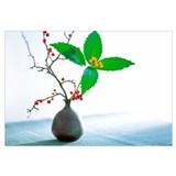 Branch and Leaves of Berry Plant in Vase on Table