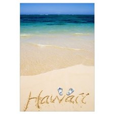 Pair Of Flipflops And Hawaii Written In The Sand,