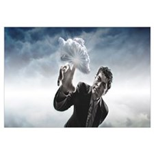 Man touching a cloud with finger