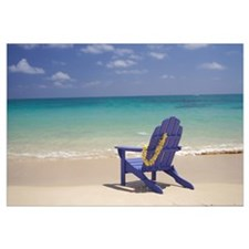 Plumeria Lei Hanging Over Blue Beach Chair Along S