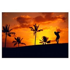 Silhouetted Golfer In Dramatic Orange Sunset Sky