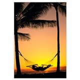 Silhouetted Couple Laying In Hammock On Beach At S