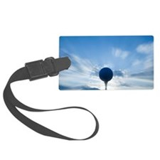Golf ball on tee, close-up Luggage Tag