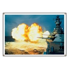 Guns firing from the USS Iowa Banner