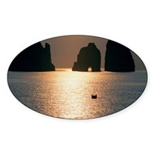 Silhouette of cliffs in the sea dur Decal