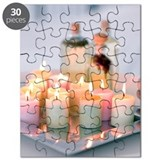 Lit aromatherapy candles on tray Puzzle
