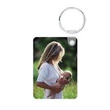 Woman breastfeeding baby i Keychains