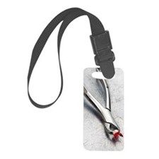 Tooth extractor with molar on sc Luggage Tag