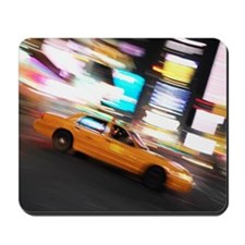 side profile of a taxi cab on the street Mousepad