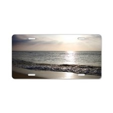 Sunlight on ocean beach Aluminum License Plate