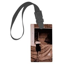 Woman Leans over Banner Luggage Tag