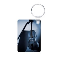 A cello leaning on a wall  Aluminum Photo Keychain