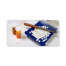 Pills on counting tray with Aluminum License Plate
