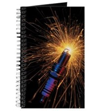 close-up of a spark plug sparking Journal