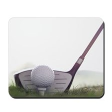 close-up of a golf club and a golf ball Mousepad