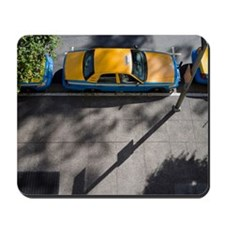 taxicabs parked along a sidewalk Mousepad