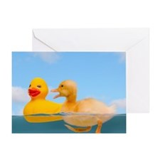 Duckling and rubber duck in water, s Greeting Card