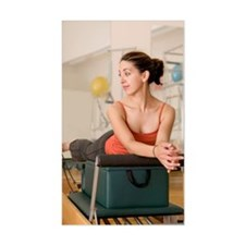 Young woman lying on Pilates b Decal