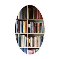 Various books on shelves Oval Car Magnet