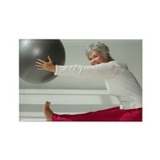 Mature woman stretching with exer Rectangle Magnet