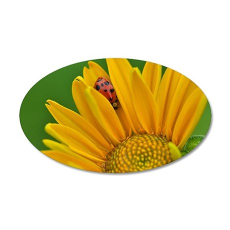 Ladybug hiding in yellow flo 35x21 Oval Wall Decal