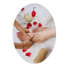 Woman receiving pedicure treatment Ornament (Oval)