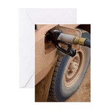 A gasoline pump in the gas tank of a Greeting Card