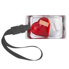 still life of red heart covered  Luggage Tag