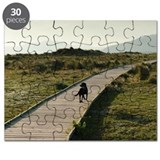 A Dog Walking Down A Boardwalk In Costa De  Puzzle