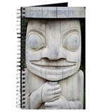 Carved wooden totem pole, close-up Journal